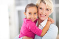 Happy grandmother granddaughter with embracing at home Stock Image