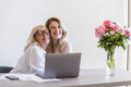 Happy grandmother hugging her young granddaughter Royalty Free Stock Photo