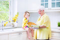 Happy grandmother and little girl baking a pie in a white kitche beautiful great her adorable granddaughter curly toddler colorful Royalty Free Stock Photography