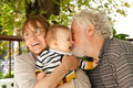 So happy grandparents having great fun with their grandchild Stock Photos