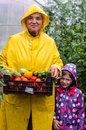 Happy granny with niece in the green house Stock Photography