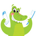 Happy green crocodile is smiling while holding a toothbrush and a toothpaste Royalty Free Stock Photo