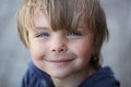 Happy grimy kid against blurred background Royalty Free Stock Images