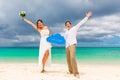 Happy groom and bride having fun on the sandy tropical beach we wedding honeymoon concept Stock Images
