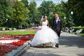 Happy groom and bride on wedding walk in park Royalty Free Stock Images