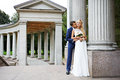 Happy groom and happy bride in wedding walk among the ancient columns Royalty Free Stock Images