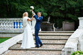 Happy groom and happy bride in wedding walk summer park Stock Photos