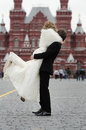 Happy groom holding young beautiful bride Stock Images