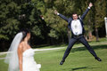 Happy groom in jump very Royalty Free Stock Image