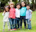Happy group of children together at the park Stock Photos
