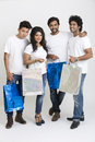Happy group of friends standing with shopping bags small on white Stock Photos