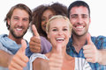 Happy group giving thumbs up on white background Royalty Free Stock Images