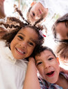 Happy group of kids hugging at the park Royalty Free Stock Image