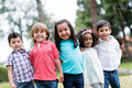 Happy group of kids smiling at the park Stock Photography