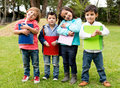 Happy group of school kids holding notebooks outdoors Royalty Free Stock Photo