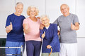 Happy group of seniors holding thumbs up in a nursing home Stock Images