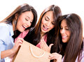 Happy group shopping girls looking their purchases isolated over white Royalty Free Stock Images