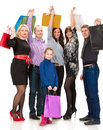 Happy group of shopping people holding bags on a white background Royalty Free Stock Image