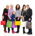 Happy group of shopping people holding bags on a white background Royalty Free Stock Photography