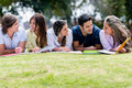 Happy group of students having fun outdoors Stock Image
