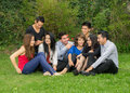 Happy group of students sitting at the park Royalty Free Stock Photo