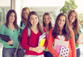 Happy group of students smiling Royalty Free Stock Photo
