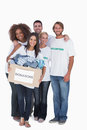 Happy group of volunteers holding donation box on white background Stock Image