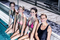 Happy group of women sitting poolside Royalty Free Stock Photo