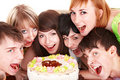 Happy group of young people with cake. Royalty Free Stock Photo