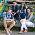 Happy group of Young people posing outdoors Royalty Free Stock Photo