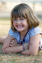 Happy grubby child portrait of cute little girl with face grinning Stock Images