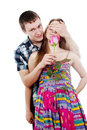 Happy guy gives a girl a rose Stock Photos