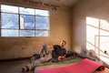 Happy guy man resting lying smiling old room abandoned mattress under window mountains ridge view. Royalty Free Stock Photo