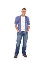 Happy guy standing with hands in pockets young Royalty Free Stock Photo