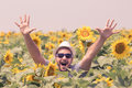 Happy guy in sunflowers field Royalty Free Stock Photo