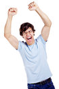 Happy guy winning screaming young man in glasses blue shirt and jeans with raised fists isolated on white background mask included Royalty Free Stock Photos