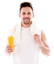 Happy gym man drinking water after workout isolated over white Stock Photos