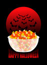 Happy Halloween. bowl and candy corn. Moon and bat. Sweets on p Royalty Free Stock Photo