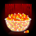 Happy Halloween. bowl and candy corn. Sweets on plate. Tradition Royalty Free Stock Photo
