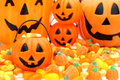 Happy halloween candy and jack o lantern holders close up Royalty Free Stock Photography