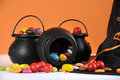 Happy Halloween candy in trick or treat carry cauldrons with witches hat Royalty Free Stock Photo