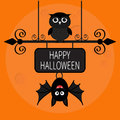 Happy Halloween card. Bat hanging on wrought iron sign board. Royalty Free Stock Photo