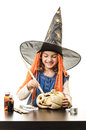 Happy halloween girl painting pumpkin little beautiful very with witch black hat tools on black table Stock Photo