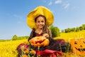 Happy Halloween girl sitting on yellow grass