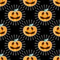 Happy Halloween jackolantern seamless pattern. Jack lantern with rays. Vector illustration isolated on black background. Royalty Free Stock Photo