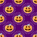 Happy Halloween jackolantern seamless pattern. Jack lantern with rays. Vector illustration isolated on purple background Royalty Free Stock Photo