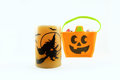 Happy halloween with orange candle and candy tote on white background Royalty Free Stock Image