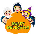 Happy halloween pumpkin kids five cute children in scary monster costumes holding a shaped billboard with the text Royalty Free Stock Photography