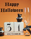 Happy halloween save the date white block calendar for october with champagne glass and chocolate muffins with black cat Royalty Free Stock Images