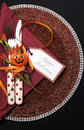 Happy halloween table place setting with red polka dot cutlery vertical and pumpkin decorations on a black tablecloth Royalty Free Stock Photos